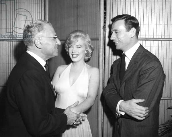 Director GEORGE CUKOR confers with co-stars MARILYN MONROE and YVES MONTAND during LET'S MAKE LOVE, 1960