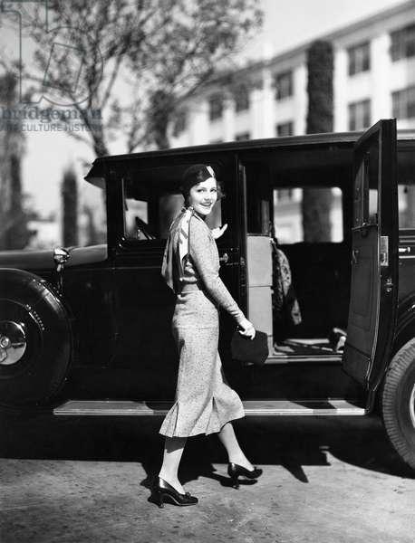 Woman Walking to Car