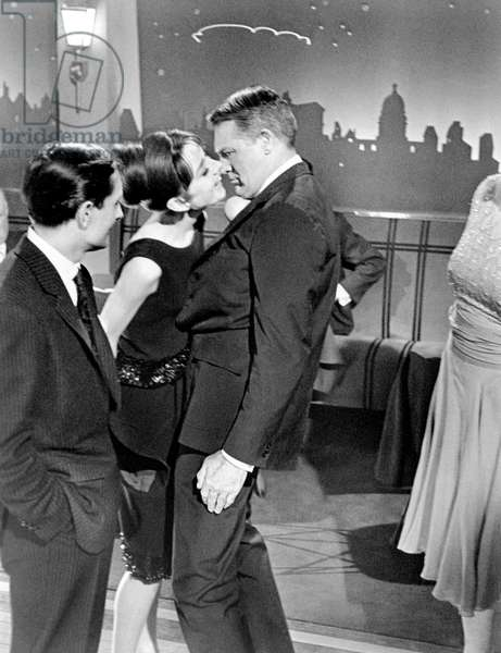 CHARADE, from left, center, Audrey Hepburn, Cary Grant, 1963