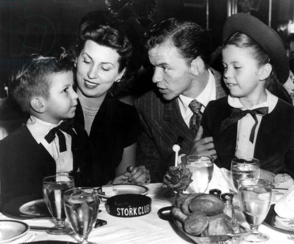 Frank Sinatra with son Frank Jr., wife Nancy, and daughter Nancy at New York's Stork Club ca. 1947
