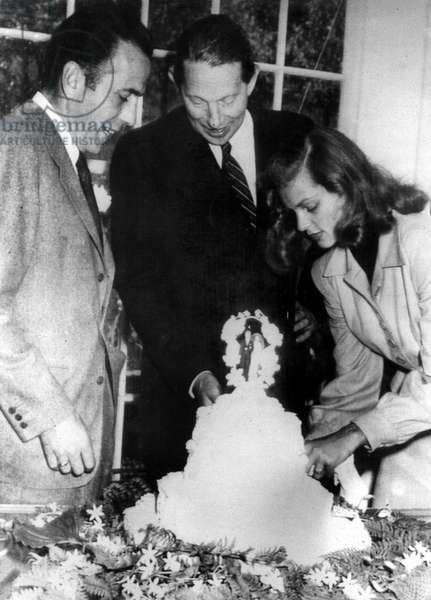 Humphrey Bogart, Louis Bromfield, Lauren Bacall during the Bogarts wedding at Bromfield's farm, 1945