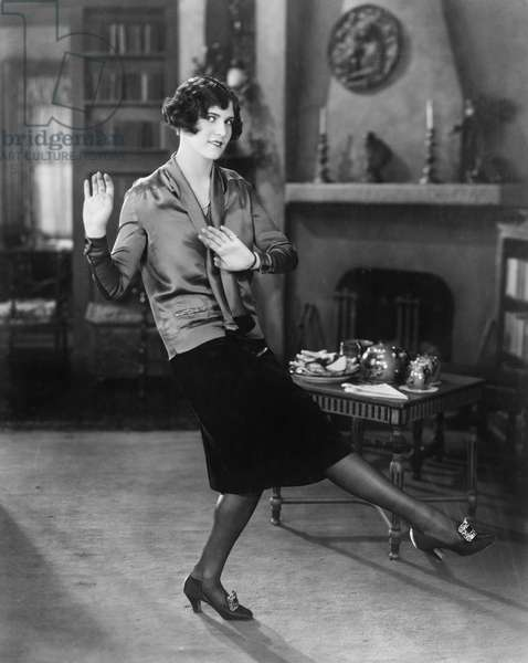 Young Woman Dancing in her Living Room