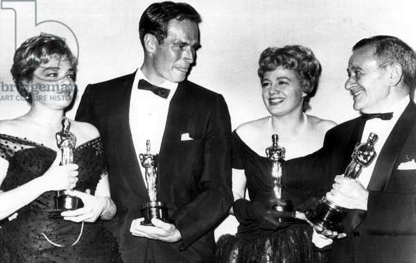 CHARLTON HESTON, with Simone Signoret, Shelley Winters, and director William Wyler with their Academy Awards at the 32nd annual ceremony April 4th, 1960
