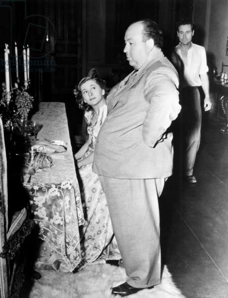 REBECCA, from left: Joan Fontaine, director Alfred Hitchcock on set, 1940