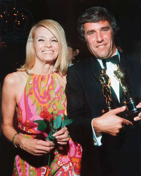 ANGIE DICKINSON (wearing a Pucci dress) with husband BURT BACHARACH holding his Academy Awards for Butch Cassidy (Best Score & Best Original Song), 1970