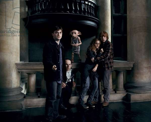 Harry Potter 7: HARRY POTTER AND THE DEATHLY HALLOWS: PART 1, from left: Daniel Radcliffe, Kreacher, Dobby, Emma Watson, Rupert Grint, 2010. ©2010 Warner Bros. Ent. Harry Potter publishing rights ©J.K.R. Harry Potter characters, names and related indicia are trademarks of and ©Warner Bros. Ent. All rights reserved./Courtesy Everett Collection