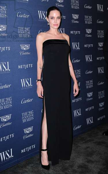 Angelina Jolie Pitt (wearing a Tom Ford dress) at arrivals for Wall Street Journal's WSJ Mag Innovator Awards 2015, Museum of Modern Art (MoMA), New York, NY November 4, 2015. Photo By: Gregorio T. Binuya/Everett Collection