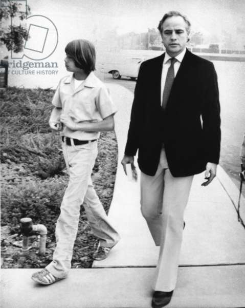 Marlon Brando, right, with his son, Christian Brando, en route to a Santa Monica custody battle with Brando's ex-wife, Anna Kashfi, April 1974