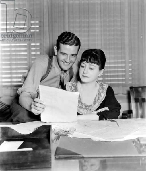 DOROTHY PARKER and her husband, Alan Campbell, working together on the script One Hour Late. 1934 - CPL Archives/Everett Collection