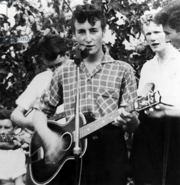 John Lennon at the microphone performing with the Quarry Men Skiffle Group in Liverpool on the day he would meet Paul Mccartney, 7/6/57