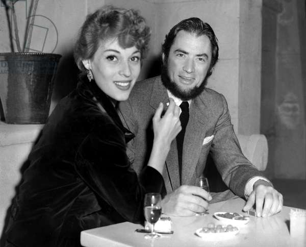 Veronique Passani, Gregory Peck in his MOBY DICK beard at a restaurant, 1955