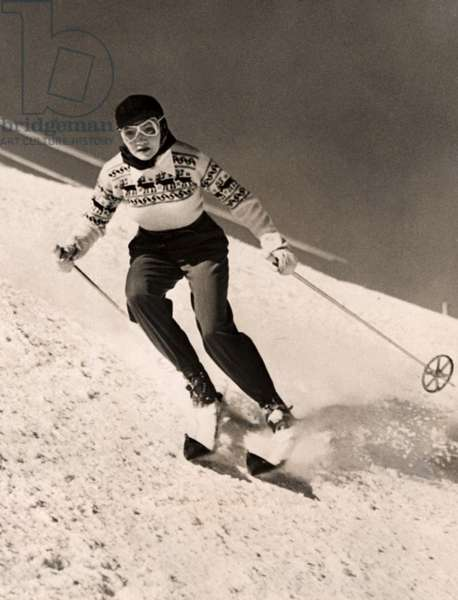 CLAUDETTE COLBERT enjoys a Sun Valley skiing holiday, 3/6/40