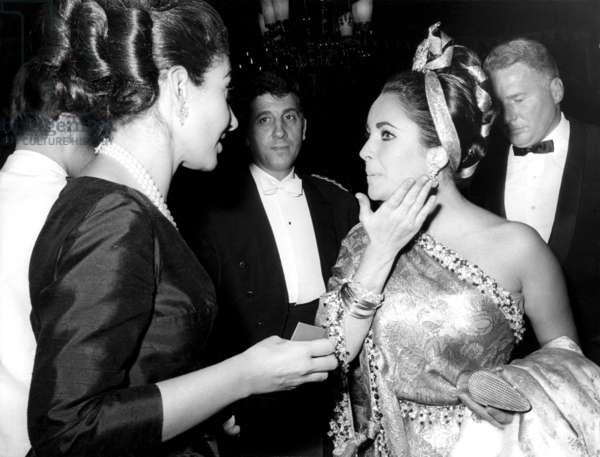 Elizabeth Taylor (right) chats with Maria Callas, c. 1960s