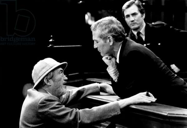 Le Piege: THE MACKINTOSH MAN, actor/director John Huston (lower left), Paul Newman (right center), on-set, 1973