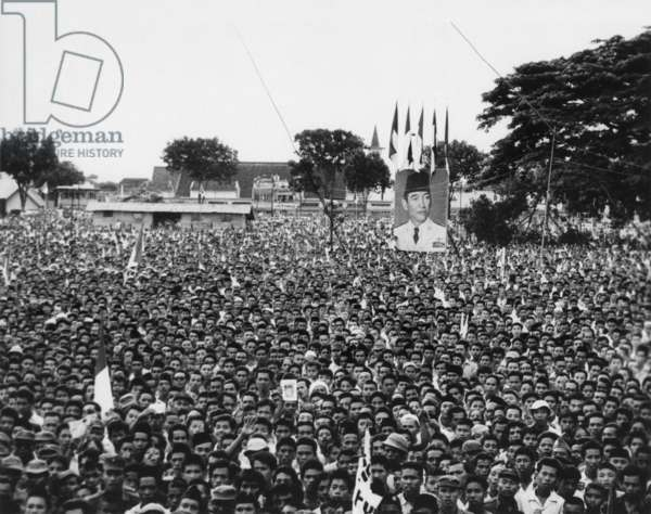 Massive demonstration in favor of President Sukarno in Makassar, Indonesia. After the first volatile decade of independence politics, Sukarno promoted 'Guided Democracy'. The resulting centralization of power around Sukarno was controversial, but he remai: Massive demonstration in favor of President Sukarno in Makassar, Indonesia. After the first volatile decade of independence politics, Sukarno promoted 'Guided Democracy'. The resulting centralization of power around Sukarno was controversial, but he remained President until 1967. - (BSLOC_2014_15_182)