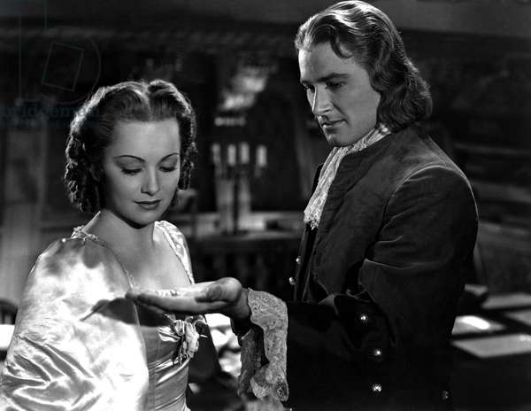 CAPTAIN BLOOD, Olivia De Havilland, Errol Flynn, 1935, presenting the pearls