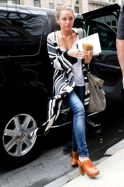 Miley Cyrus, enters Gemini 14 Hair Salon out and about for CELEBRITY CANDIDS - WEDNESDAY, , New York, NY June 16, 2010. Photo By: Ray Tamarra/Everett Collection