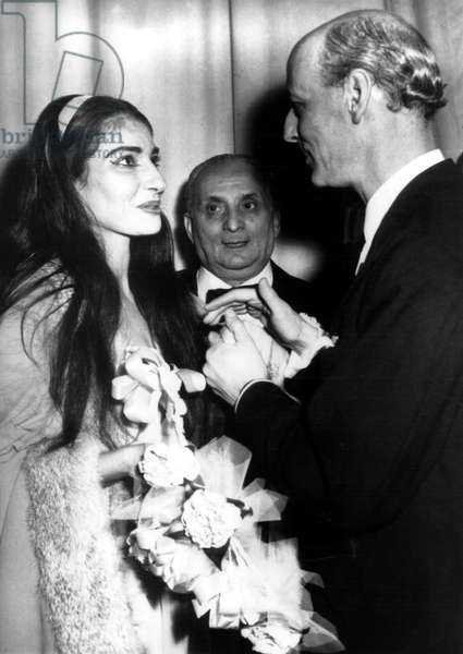 """Maria Calls is congratulated by Rudolf Bing, general manager of the Metropolitan Opera in New York, following a performance of """"La Traviata"""" at The Met. Her husband Giovanni Battista Meneghini looks on. 1958."""
