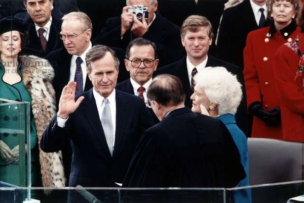 George Herbert Bush: President George Herbert Walker Bush takes the oath of office administered by Chief Justice William Rehnquist. Vice President Dan Quayle and Barbara Bush look on. January 20, 1989.