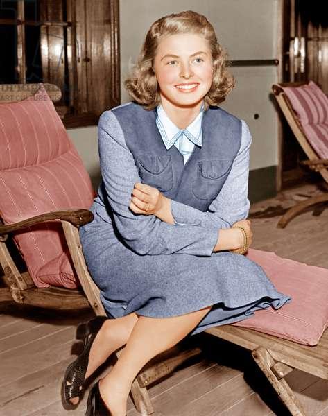 Ingrid Bergman lounges on ship deck, 1940