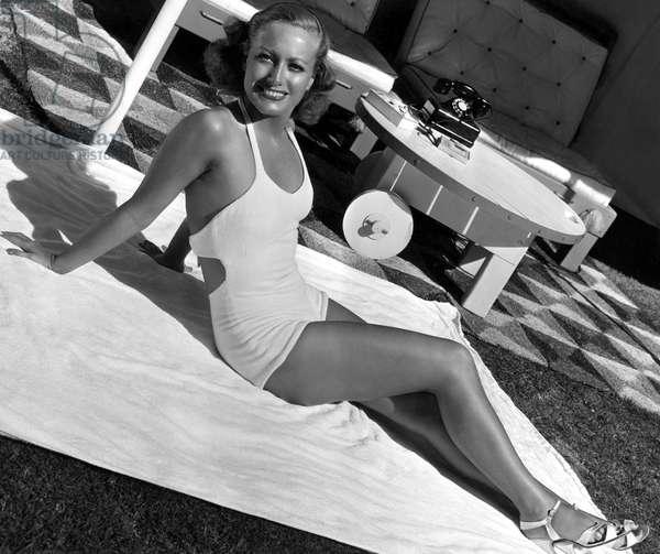 Joan Crawford getting a tan, 1934
