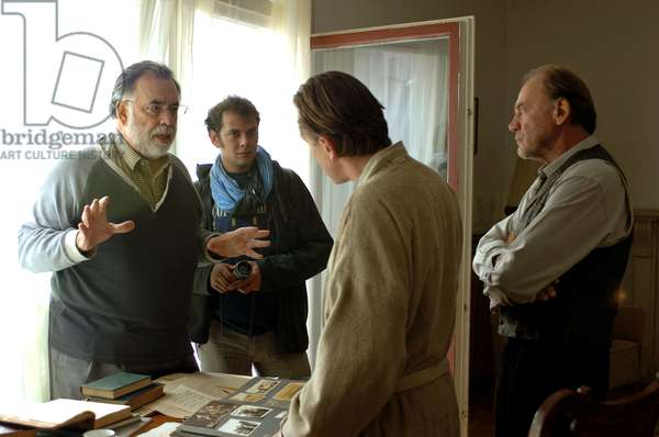YOUTH WITHOUT YOUTH, director Francis Ford Coppola (left), Tim Roth (second from right), Bruno Ganz, on set, 2007. ©Sony Pictures Classics/courtesy Everett Collection