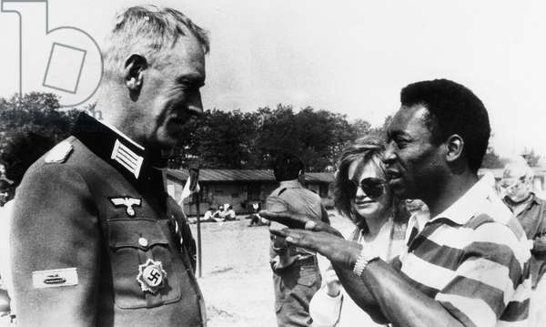 """The actor Max von Sydow together with the soccer player Pelé on the set of the film """"Fuga per la vittoria"""" (Victory) by John Huston."""