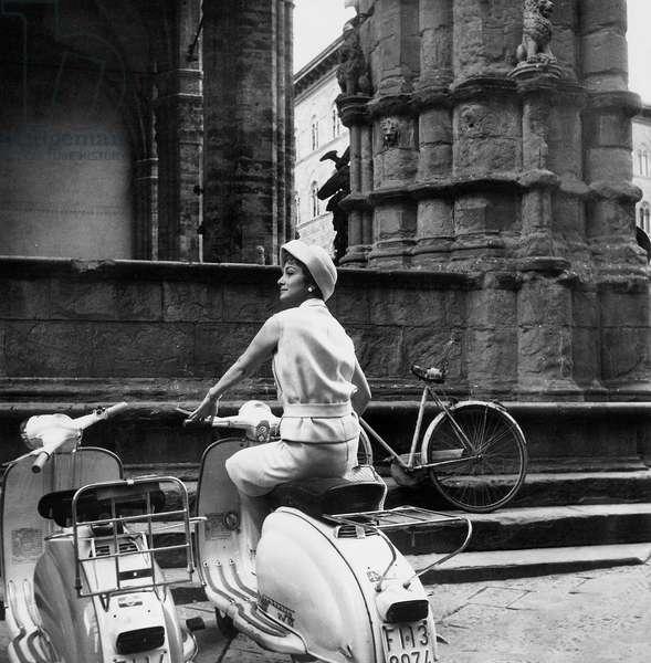 The Actress Olivia de Havilland in Lambretta near to the Loggia dei Lanzi, Florence, c.1955 (gelatin silver print)