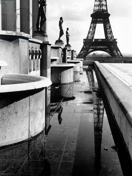 A terrace with statues near the Eiffel Tower in Paris, France (b/w photo)