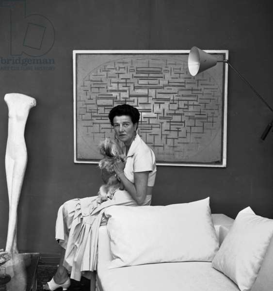 Peggy Guggenheim, in front of a painting by Piet Mondrian, Venice, Italy, 18th September 1957 (b/w photo)