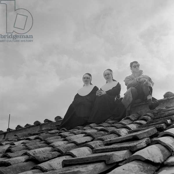 People on a rooftop awaiting the coronation of Pope John XXIII, Vatican City, 4th November 1958 (b/w photo)