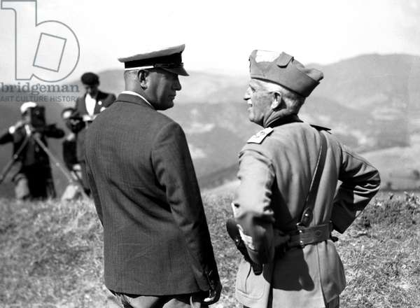 Benito Mussolini and King Victor Emmanuel III supervising military exercises in the Tuscan-Emilian Apennines, near Scarperia, between Florence and Bologna, 20th August 1934 (b/w photo)