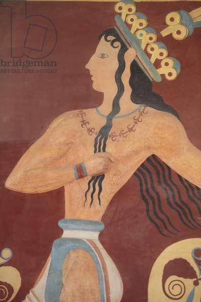 """Minoen archeological site of Knossos. Minoen art """"Prince of the Lilies"""""""" fresco. South entrance. Copy of a relief wall painting of which a few fragments were found. The reconstruction here is uncertain. The fragments of the original painting are in the archeological museum of Heraklion. Knossos, Crete."""