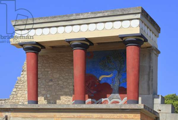 Minoen archeological site of Knossos. North entrance, North pillar Hall. Bastion reconstructed by Arthur Evans where he put a copy of a restored relief fresco of a bull. Knossos, Crete.