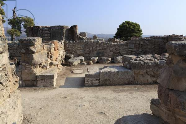 """Minoan archeological site of Phaistos. View over a """""""" Bench shrine"""""""" of the West wing. The """""""" bench Shrine"""""""" was a small and rectangular room with low benches running round the walls to support cult objects and figurine of the deity. On some of them were found female figurine, ritual vessels, and """""""" offering tables"""""""" (small altar). Phaistos, Crete?"""