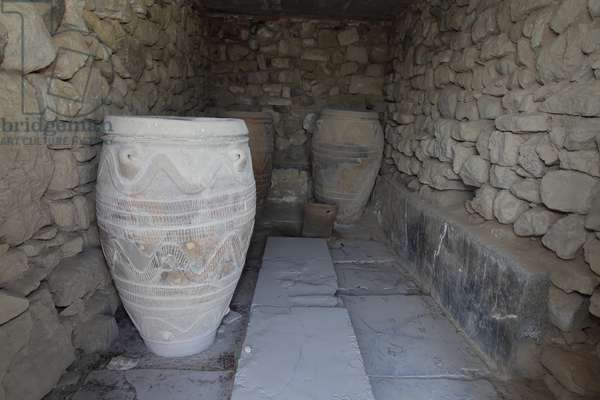 Minoan archeological site of Phaistos.The magazine of the giant pithoi (storage jars). These jars are decorated with disc and rope patterns in relief.