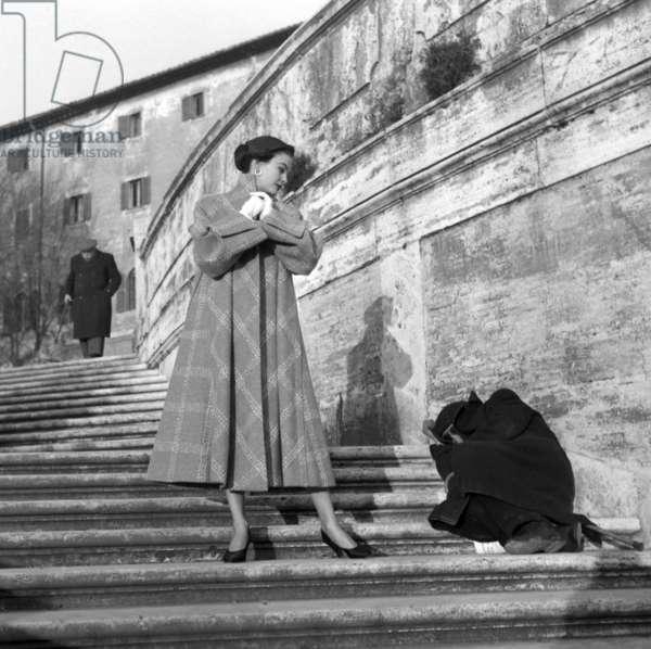 Fashion: Carosa Autumn/Winter collection, worn by Joe Patterson, Trinita dei Monti, Rome, Italy, 1953 (b/w photo)
