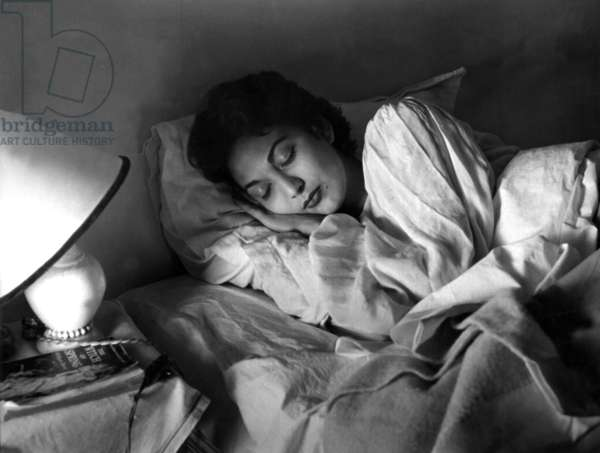 "Paris, 1952. Model Teresita Montez in bed. This picture comes from the reportage ""The Day of a Model"""