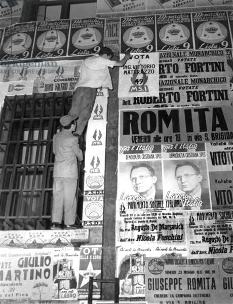 "Naples, 1953. Italian parliamentary elections of 1953, posters on the streets. ""The Battle of the Walls"" to the Conquest of Space"
