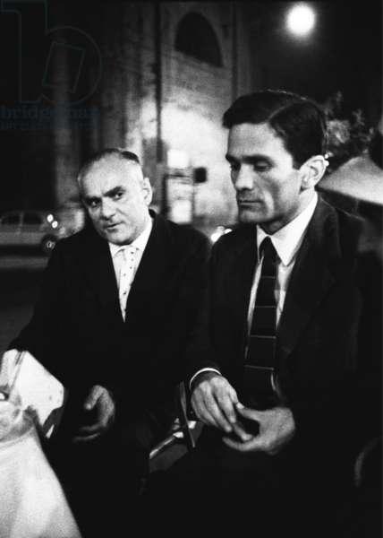 Writers Pier Paolo Pasolini and Alberto Moravia at Caffe Rosati in Piazza del Popolo, Rome, Italy, 1960 (b/w photo)