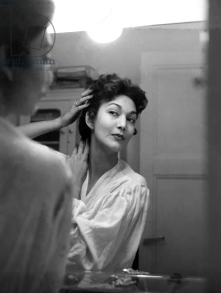 """Paris, 1952. Model Teresita Montez in the mirror. This picture comes from the reportage """"The Day of a Model"""""""