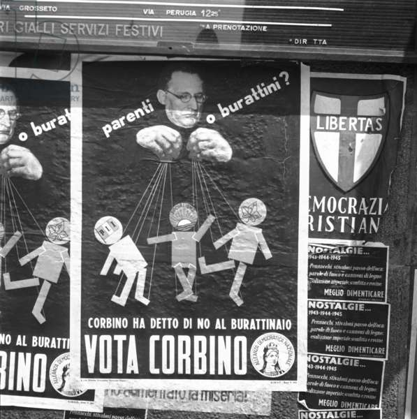 """Milan, 1953. Electoral posters for the parliamentary elections of 1953. Attack on the """"puppeteer"""" Alcide De Gaperi"""