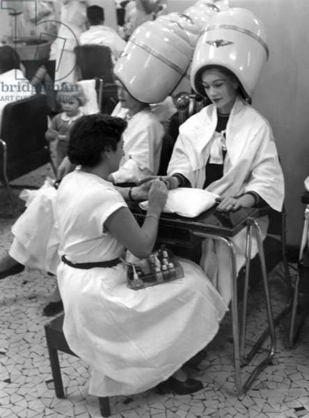 """Paris, 1952. Model Sophie Malga' at the hairdresser's and manicure. This picture comes from the reportage """"The Day of a Model"""""""