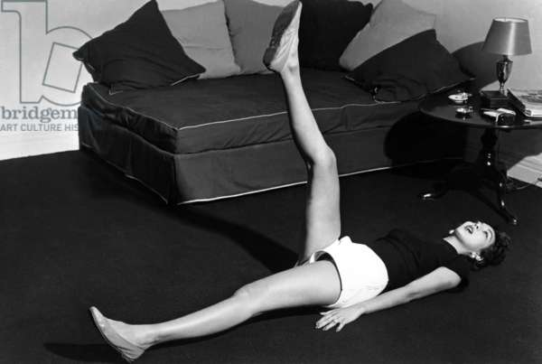 "Paris, 1952. Model Teresita Montez does early morning gymnastics. This picture comes from the reportage ""The Day of a Model"""