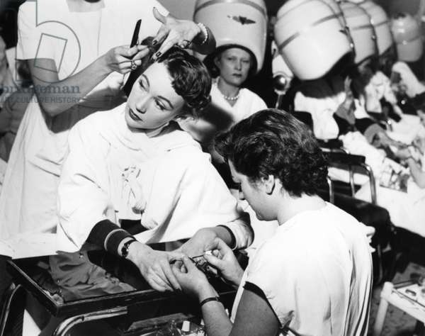 "Paris, 1952. Model Sophie Malga' at the hairdresser's and manicure. This picture comes from the reportage ""The Day of a Model"""