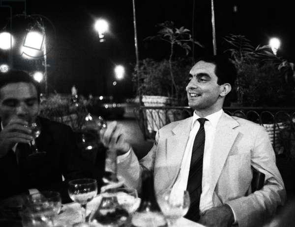 Writers Pier Paolo Pasolini and Italo Calvino at Caffe Rosati in Piazza del Popolo, Rome, Italy, 1960 (b/w photo)