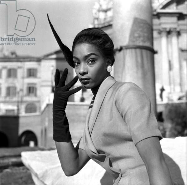 Fashion: Ferdinandi Spring/Summer collection, worn by Bambi, Imperial Forum, Rome, Italy, 1953 (b/w photo)