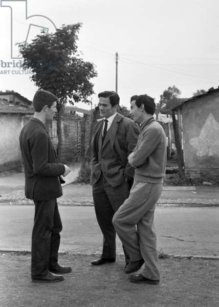 Pier Paolo Pasolini among the shacks in the township of Centocelle, Italy, 1960 (b/w photo)