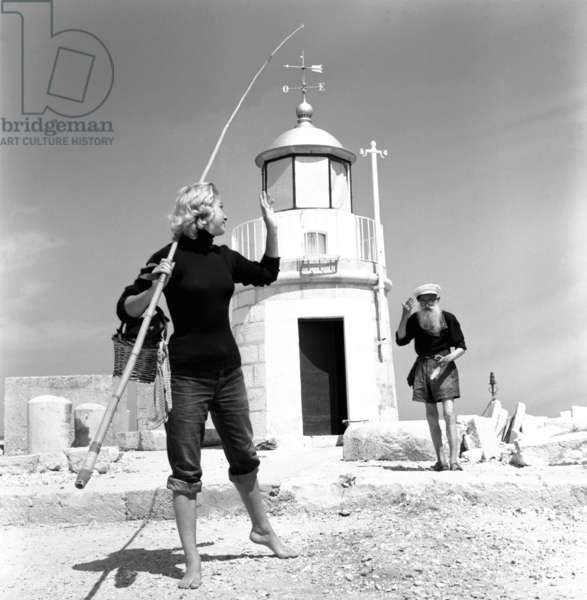 """Trani, August 1955. The wearer Margit Olsen, reportage """"The Girl of the Lighthouse""""."""