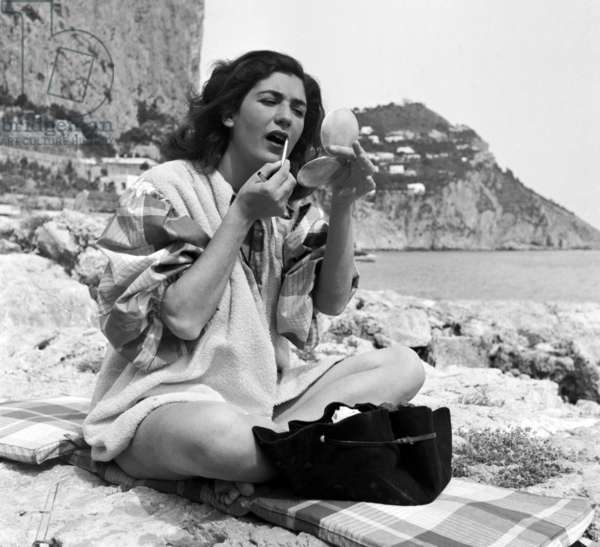 Capri, April 1952. Graziella Buontempo, a noble Neapolitan family organizer of painting exhibitions, considered one of the most beautiful women of Naples